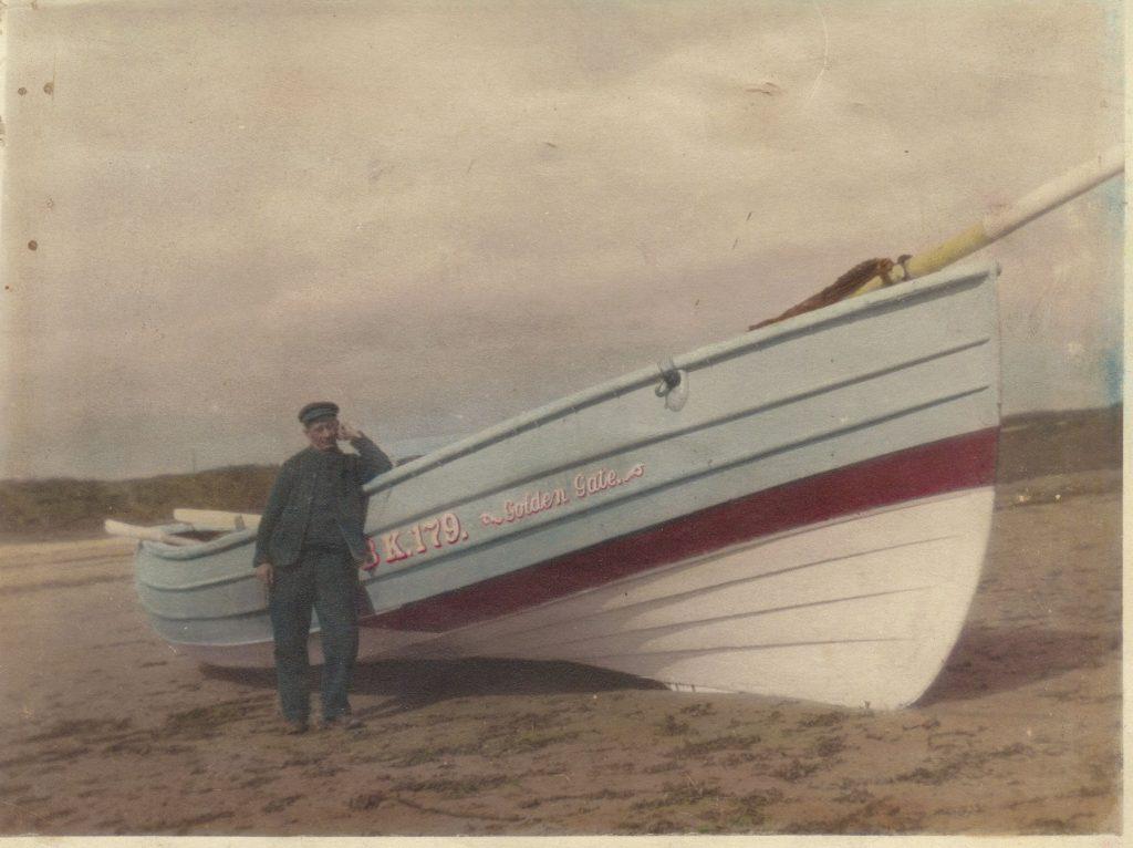 Fisherman John Percy Douglas with his coble, circa 1920