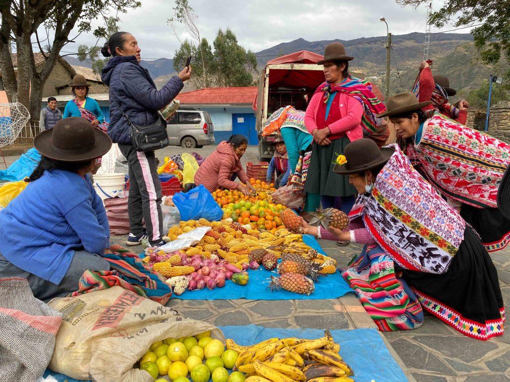 Exchange of fruits at a barter market in Lares, Peru