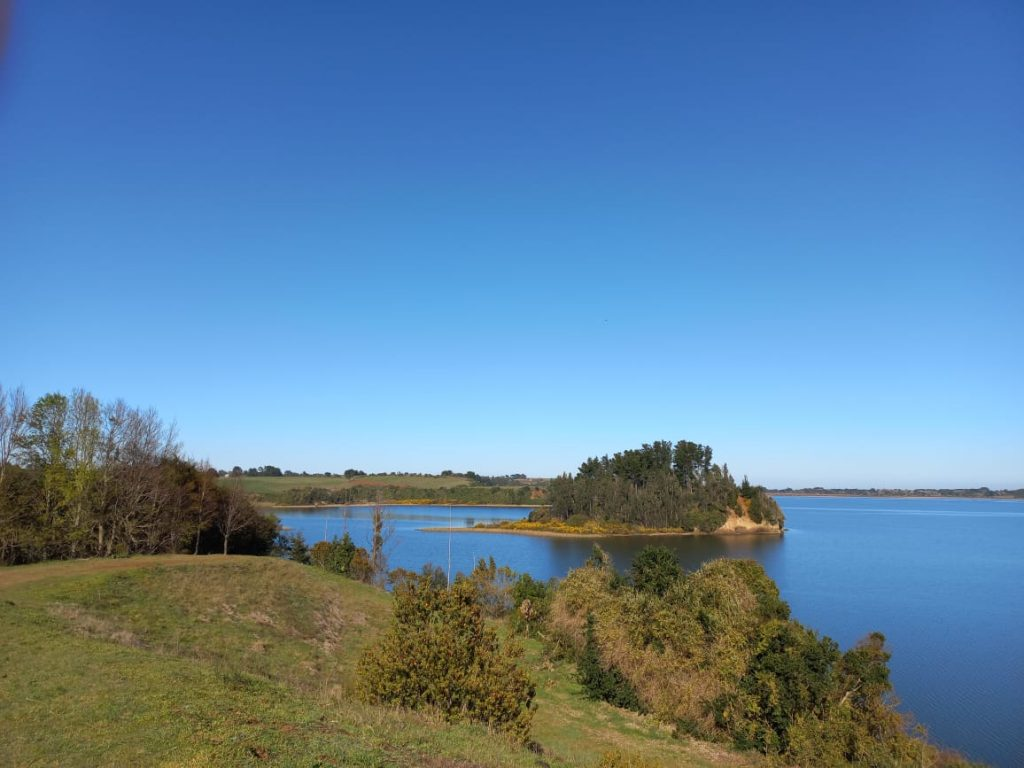 A view of Lake Budi, Chile, under blue skies